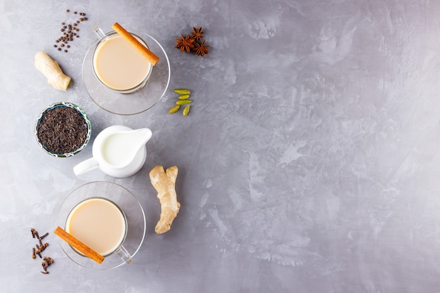 Masala chai tea. traditional indian drink - masala tea with spices on gray background.