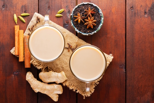 Masala chai tea with spices on burlap