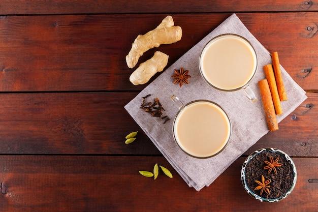 Masala chai tea with spices on linen napkin