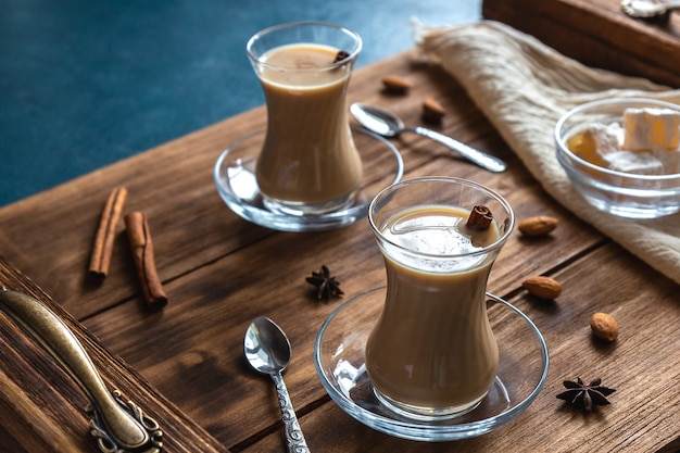 Masala chai with spices in glass cups