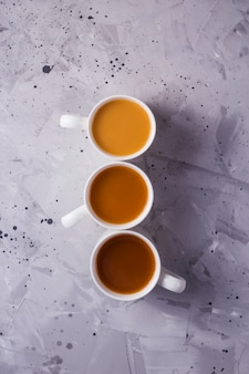 Masala tea or coffee with a different amount of milk and a different color gradient