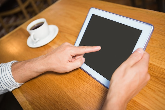 Masculine hands holding tablet