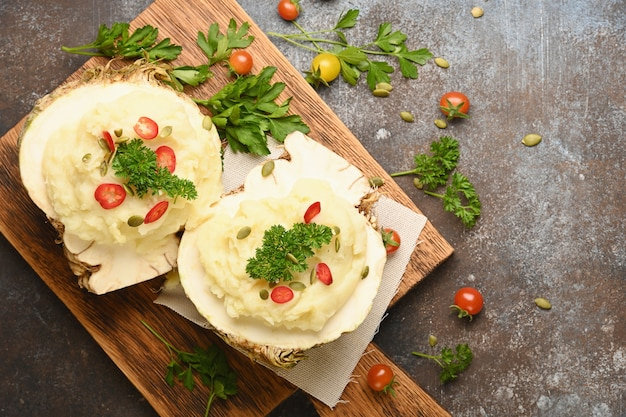 Mashed celery root on wooden cutting board