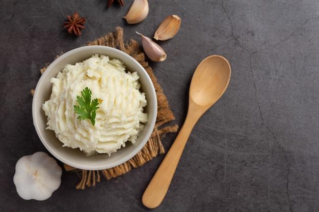 Mashed potatoes on dark background