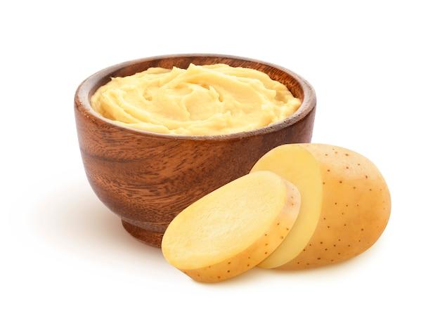 Mashed potatoes and sliced raw potato isolated on white background