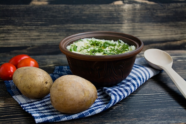 Mashed potatoes with herbs on a surface