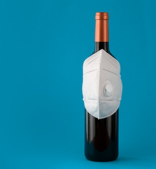 Mask on the bottle as a symbol of protection with copy space