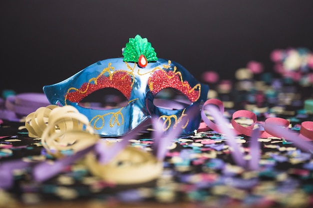 Mask and confetti on the floor
