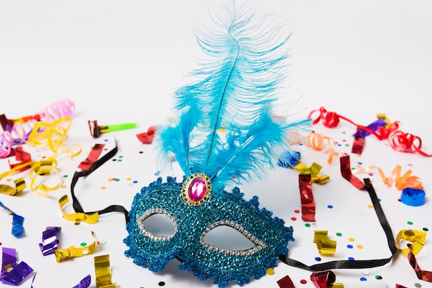 Mask with feather on confetti