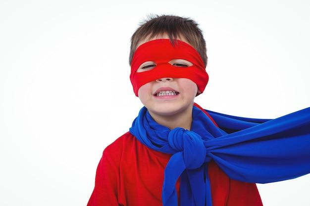 Masked boy pretending to be superhero