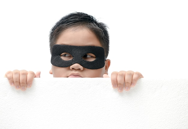 Masked child appeared from below isolated