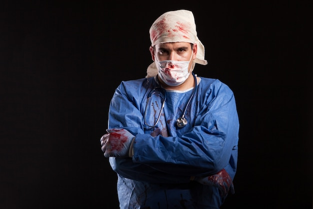 Masked crazy doctor for halloween isolated over black background. doctor with crazy mental disorder.