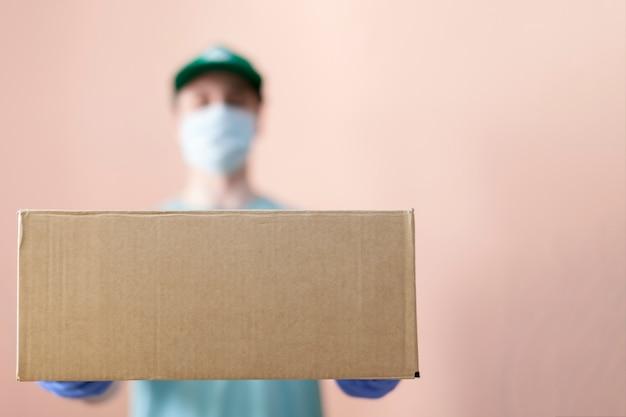Masked food delivery man