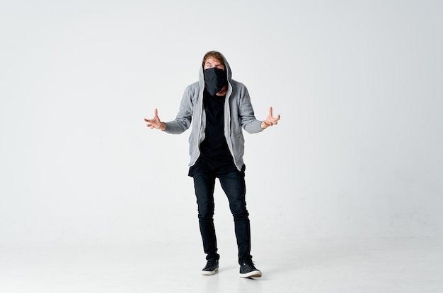 Masked hooded man hiding his face stealing emotions anonymity