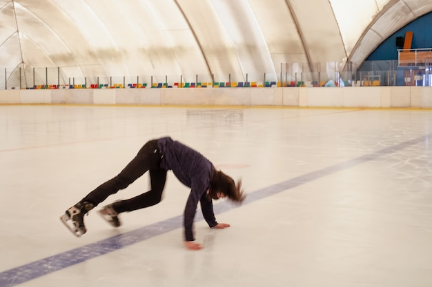A masked man falls on the ice