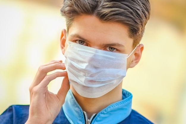 Masked man from coronavirus and air. protection against pm 2.5 air polluted from thea  virus in europe and asia