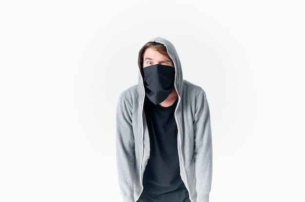 Masked man in mask with hood emotions theft