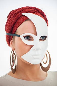Masked woman hiding her face
