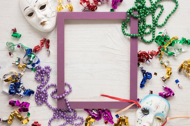 Masks and confetti with beads around frame