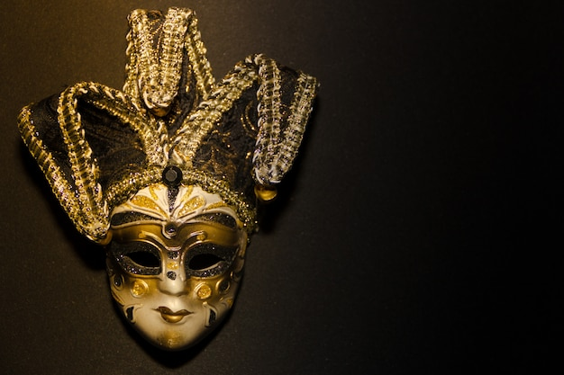 Masks and feathers of venice carnival on black background