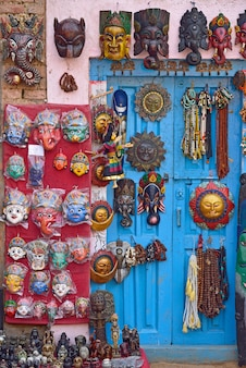 Masks, pottery, souvenirs, hanging in front of the shop on swayambhunath stupa in kathmandu, nepal