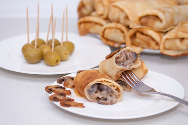 Maslenitsa. pancake rolls or french stuffed crepes with mushrooms
