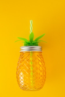 Mason jar glass cup pineapple shape, summer juice or cocktail drink isolated.