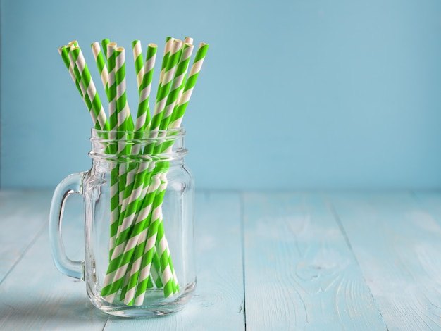 Mason jars with yellow paper straws and cap. ideal for summer drinks and smoothies.