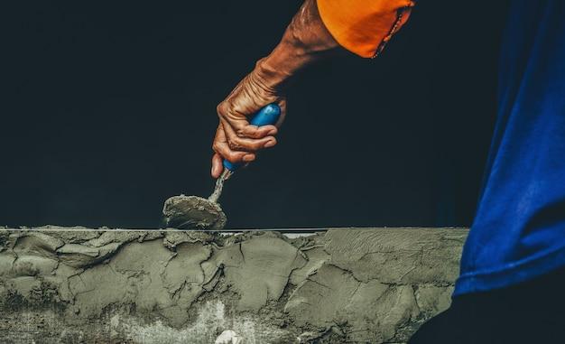 Mason rural thailand plastering concrete build wall background industrial worker plasterin