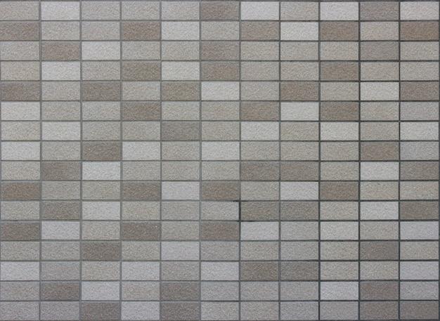 Masonry random color brick tile surface texture design wall background.