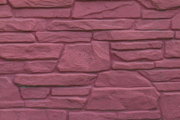 붉은 돌의 벽돌 벽