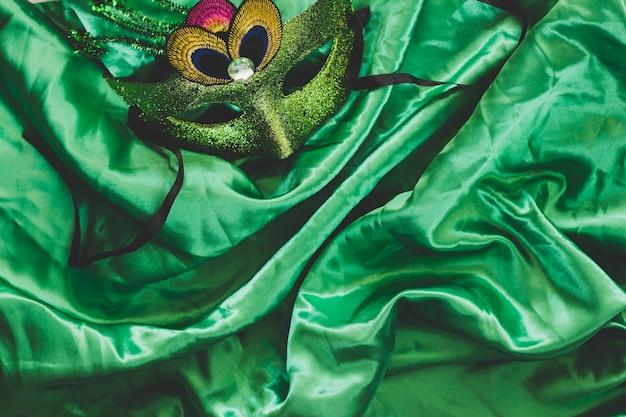 Masquerade mask on tender silk fabric