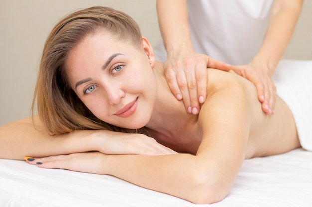 Massage and body care. spa body massage woman hands treatment. woman having massage in the spa salon for beautiful woman