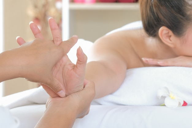 Massage by hand in a spa room