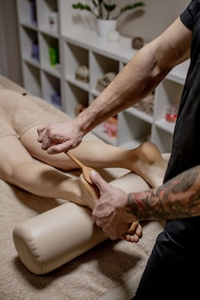 Massage of human foot in spa salon - soft focus image.