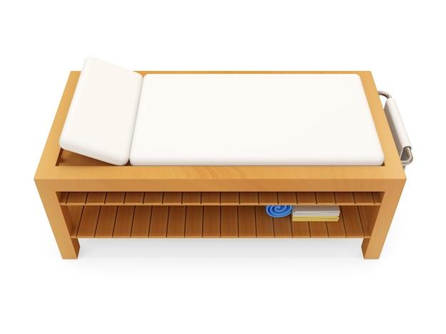흰색 배경에 고립 된 마사지 테이블