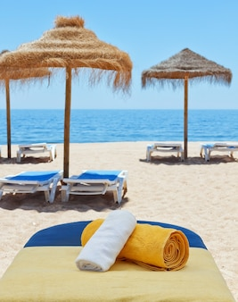 Massage therapy for sunbed on the beach. near the sea.