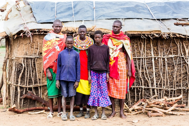 Massai family looking in camera
