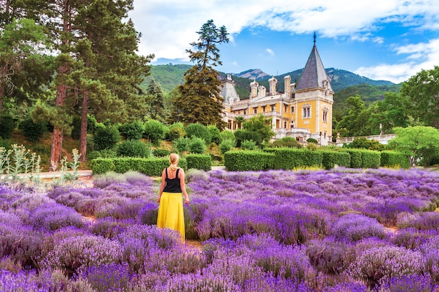 Massandra palace in crimea. the girl in the lavender field  by  the castle.