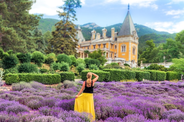 Massandra palace in crimea. the girl in the lavender field on the table of the castle.