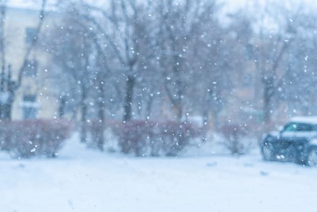 A massive snowfall outdoors during winter season