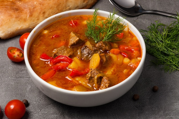 Mastava is a traditional uzbek soup in a white bowl