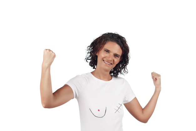 Mastectomy concept. smiling positive young woman with t-shirt depicting  awareness for breast cancer.