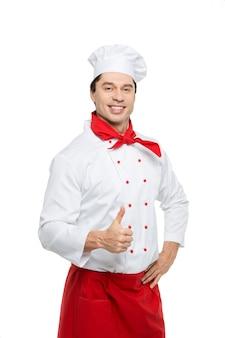 Шеф-повар показывает палец вверх стоя на белом. Premium Фотографии