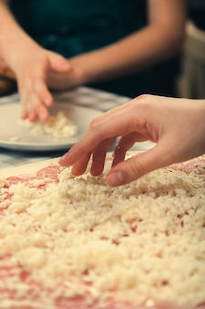 Master class on cooking pizza in a pizzeria