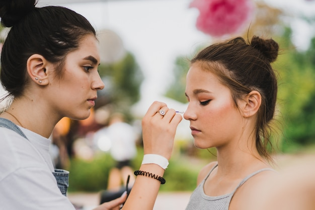 Master class make-up. girl makes make-up to her friend