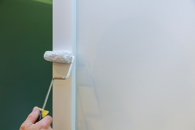 The master paints wooden moldings
