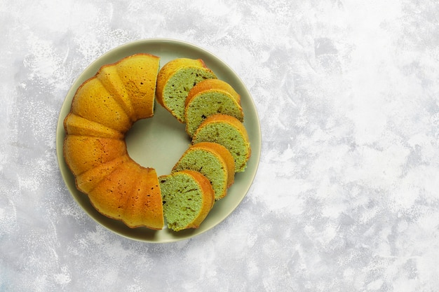 Matcha green tea bundt cake on grey stone  top view copy space