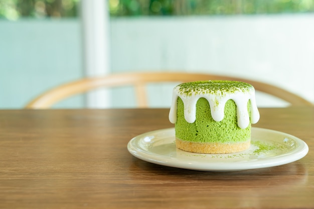Matcha green tea cheese cake on table in cafe restaurant