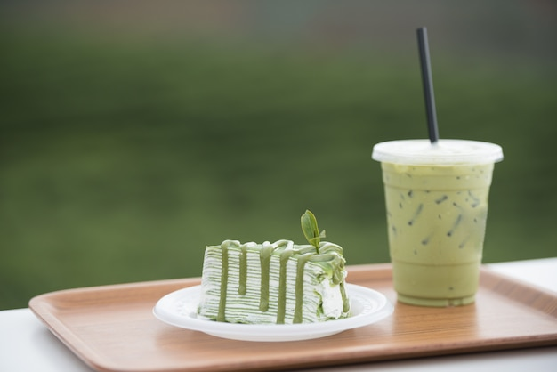 Matcha green tea crepe cake and green tea milk, product from green tea leaf.
